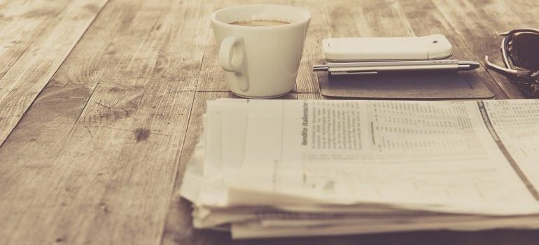 Newspaper on a table.