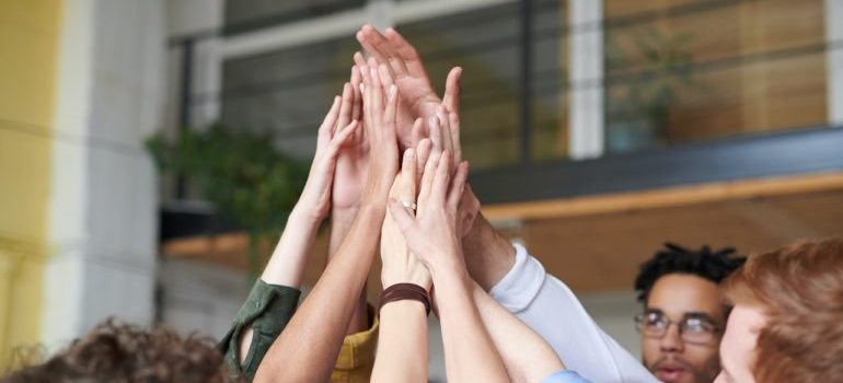 A group of people high-fiving